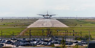 The plane makes landing on the runway at day time stock photo