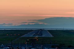 The plane makes a night landing on the runway royalty free stock photo