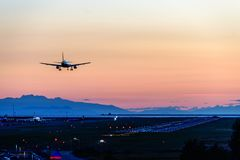 The plane makes a night landing on the runway stock images