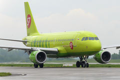 Plane makes taxiing on taxiway Domodedovo International Airport Royalty Free Stock Photo