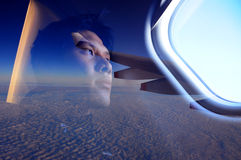 On the Plane. The man looking out of a plane window. He need to go home stock photos