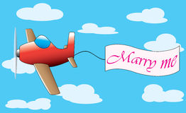 Plane with marry me bannereart as a symbols of reconciliation Royalty Free Stock Photography