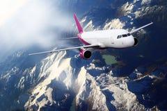 Plane mauve pink sky cloud travel transportion airplane mountains. Plane mauve pink cloud travel transportion airplane Royalty Free Stock Photo