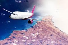 Plane mauve pink sky cloud travel transportion airplane mountains. Plane mauve pink cloud travel transportion airplane Stock Images