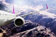 Plane mauve travel transportion airplane mountains. Plane black white travel transportion airplane Royalty Free Stock Image