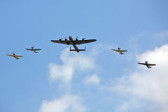 Plane, Military planes flying. Planes in precision flight formation and sequence Stock Photos