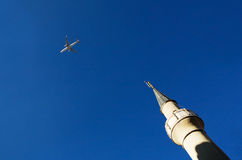 Plane and minaret Royalty Free Stock Images