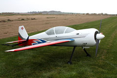 Plane model. Standing on the earth Stock Image