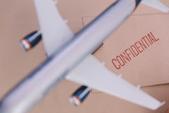 The Plane Model Over The Confidential Brown Envelop Royalty Free Stock Photos