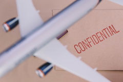 The Plane Model Over The Confidential Brown Envelop Stock Image