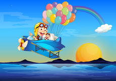 A plane with monkeys and balloons Royalty Free Stock Photography