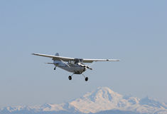 Plane with mountain back drop. Plane with Mount Baker in the background Stock Photos