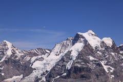 Plane & Mountains. View from Mt. Schilthorn, Switzerland Stock Photos