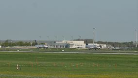 Lufthansa planes taxiing in Munich Airport, spring. Plane movement in Munich Airport MUC. green grass stock video