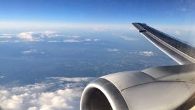 Plane is moving over the city and the countryside. Nice view from the porthole stock video