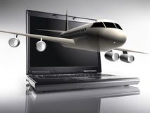 Plane and netbook Stock Photography