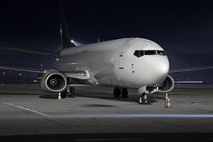Plane at night Stock Photos