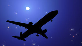 Plane in the night sky Royalty Free Stock Images