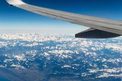 Plane over the alps royalty free stock photography