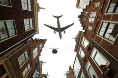 Plane over Amsterdam Royalty Free Stock Images