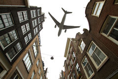 Plane over Amsterdam Royalty Free Stock Image