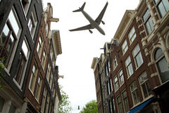 Plane over Amsterdam Stock Photos