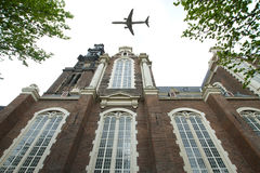 Plane over Amsterdam Royalty Free Stock Photography