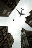 Plane over Amsterdam Stock Photo