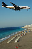Plane over beach Stock Images