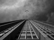 Plane over building Stock Image