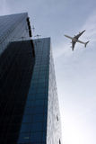 Plane  over a city Royalty Free Stock Photos