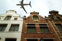 Plane over the city of Brussels tilt - shift Royalty Free Stock Images