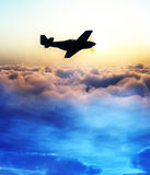 Plane Over The Clouds 3. A plane flying over a abstract starry cloud and sun scene Stock Photography