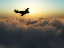 Plane Over The Clouds. A plane flying over some clouds Stock Images