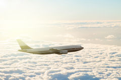 Plane over clouds Stock Photo