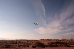 Plane over desert Royalty Free Stock Photography
