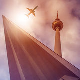 Plane over Fernsehturm. Plane flying over the famous Berlin tv tower, Berlin, Germany Royalty Free Stock Image