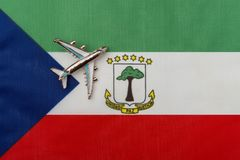 Plane over the flag of Equatorial Guinea travel concept. Toy plane on the flag in the background royalty free stock photos