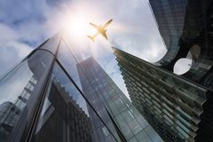 Plane over highrise buildings Royalty Free Stock Photos