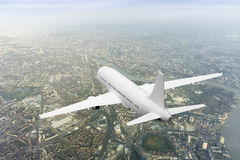Plane over London. 3d rendering of a plane over London Royalty Free Stock Images