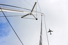 Plane over the mast stock photography