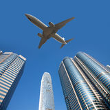 Plane over modern city Royalty Free Stock Image