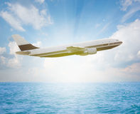 Plane over ocean Royalty Free Stock Photo