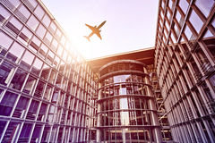 Plane over office building Royalty Free Stock Photography