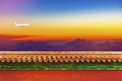 Plane over the red walls, meaning China and East Asia airline tr Royalty Free Stock Images