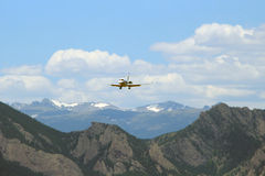 Plane over the Rocky Mountains Royalty Free Stock Photo