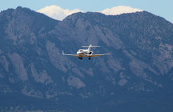 Plane over the Rocky Mountains Royalty Free Stock Photos