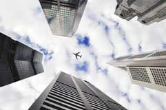 Plane over skyscrapers Royalty Free Stock Image