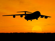 Plane over sunset. Silhouette of airplane over orange sky Royalty Free Stock Image