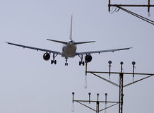 Plane Overflying Signs. Royalty Free Stock Photos